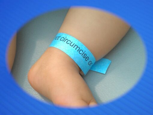 Do not circumcise ankle band worn by infant