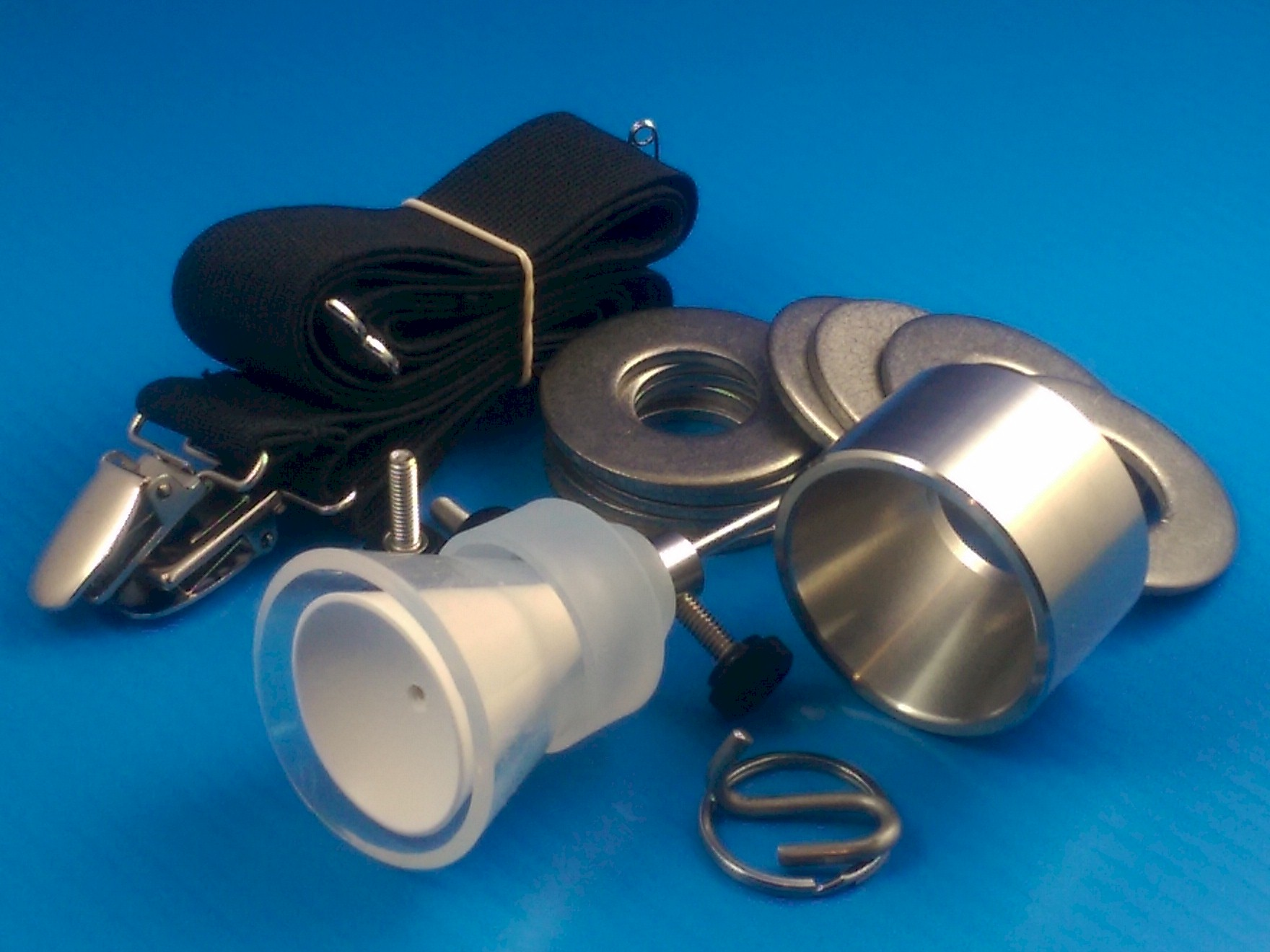 TLC Hanger / weights kit includes 13.5 ounces of stainess weights, retaining Cuff, strap, SGX clip, and Collar