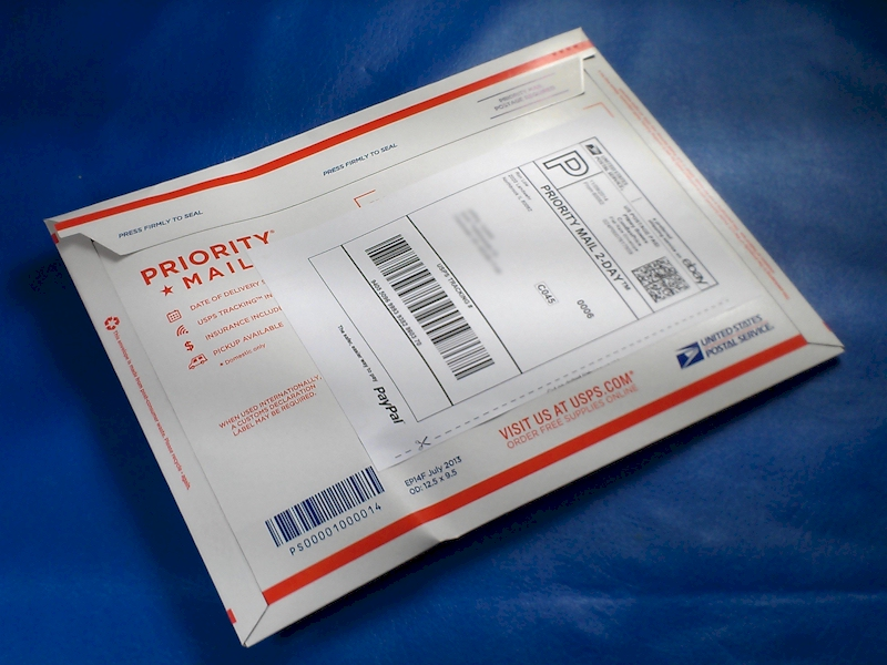 Express Mail parcels are packed in a cardboard document sleeve