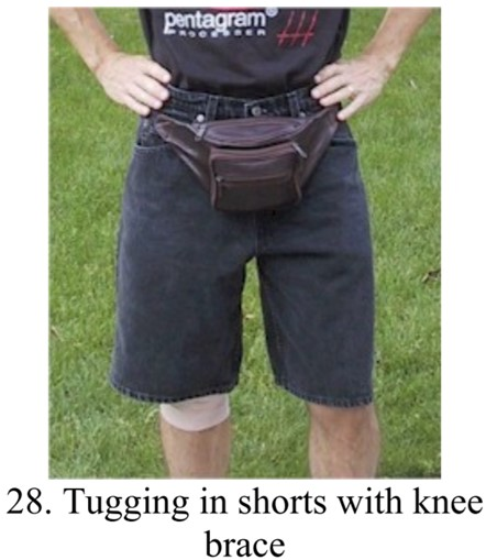 Tugging with a strap and a redundant knee brace in shorts